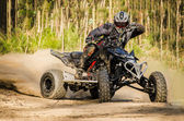 ATV racer takes a turn during a race. — Stockfoto