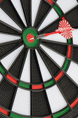 Dart board with dart — Stock Photo