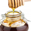 Jar of honey with wooden drizzler — Stok fotoğraf