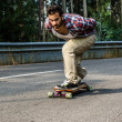 Downhill skateboarder in action — Stock Photo #30461045