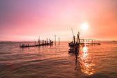 Old dock sunrise — Stock Photo