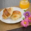 Croissants with orange juice — Stock Photo