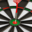 Stock Photo: Dart board with dart