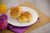 Croissants with orange juice  — Stock Photo