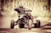 ATV racer takes a turn during a race.  — Stock Photo