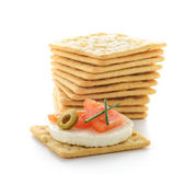 Crackers with cheese and tomato — Stock Photo