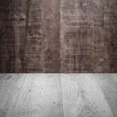 Table with brown wall — Stock Photo