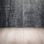 Table with gray wall — Stock Photo