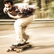 Downhill skateboarder in action — Stock Photo #48581047