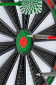 Dart board with darts — Photo