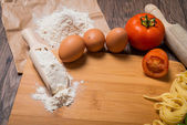 Raw pasta, tomato and eggs — Stock Photo