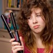 Girl having bad hair day - Stock Photo