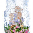 Stock Photo: Delicate bouquet of flowers in ice