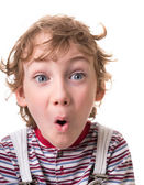 Curly-haired boy surprised — Stock Photo