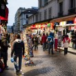 Evening buzz around souvenir shops in Paris, France — Stock Photo #27063689