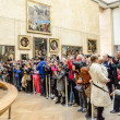 Stock Photo: Visitors admire portrait of MonLisa