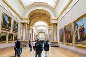 Trippers in the visit of Louvre Museum — Stock Photo