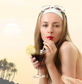 Caucasian woman drinks unrecognizable cocktail — Stock Photo