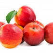 Red Apples with green leaf on white — Stock Photo