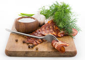Rough simple still life with bacon — Stock Photo