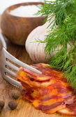 Rustic still life with a slice of sausage — Stock Photo