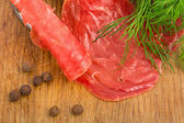 Still Life with slices of smoked meat — Stock Photo