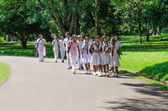 Group of pupils in a traditional school clothes on excursion in — Stock Photo