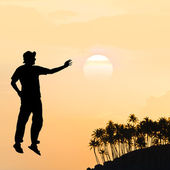 Male silhouette on background amazing sunset — Stock Photo