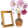 Photo frame and antique vase with decorative garden flower — Stock Photo #12176345