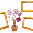 Photo frame and antique vase with decorative garden flower — Stock Photo #12198597