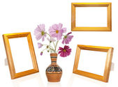 Photo frame and antique vase with decorative garden flower — Stock Photo