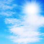 Blue sky background with white clouds — Stock Photo