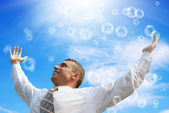 Pink dreams happy businessman on a blue sky — Stock Photo