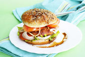 Burger with meat and baked vegetables — Stock Photo