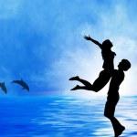 Loving couple at sea — Stock Photo