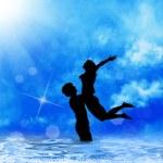 Loving couple at sea dawn — Stock Photo #14893691