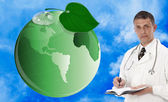 Ecology concept. Green planet and innovative medicine — Stock Photo