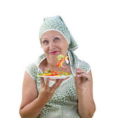 Adult female eating fresh vegetable salad — Stock Photo