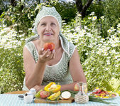 Senior female and fresh healthy vegetable food — Stock Photo