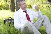 Businessman drinks milk — Stock Photo