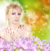 Beautiful Girl With Orchid Flowers. — Stock Photo