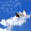 Engineer on the clouds and electrical scheme. Engineering designing — Stock Photo #30967589