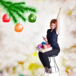 Happy red-haired girl with gifts and phone on a chair.Holidays Christmas and New Year — Stock Photo #36809371