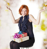 Happy red-haired woman with boxes gifts.Holiday concept — Foto de Stock