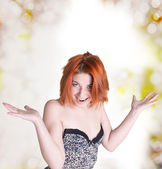 Emotional happy woman with red hair on abstract festive background — Stock Photo