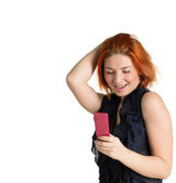 Emotional happy woman with red hair and a telephone — Stock Photo