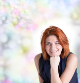 Happy smiling woman with red hair on abstract festive background — Stock Photo
