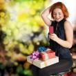 Happy smiling red-haired woman with boxes gifts.Holiday concept — Stock Photo