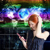 Happy red-haired girl with a mobile phone.Globalization Internet Connect technologies — Stock Photo