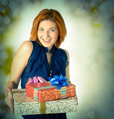 Happy smiling red-haired woman with boxes gifts.Holiday — Stock Photo
